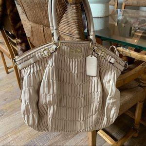 Cream coach bag with satin interior